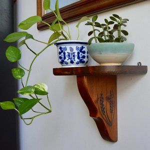 Vintage Wooden Shelf with Woodcut Embellishment